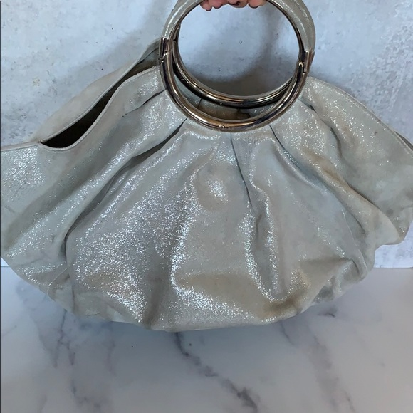 Dior silver handbag very well loved needs cleaning